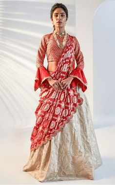 Beautiful Silk Lehenga-Choli with superb embellishments with hand embroidery.