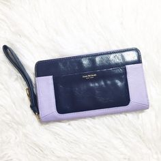 "Isaac Mizrahi clutch wallet 💜 Purple leather Isaac Mizrahi New York clutch wallet Tags still attached ""I"" engraved on zipper Wrist strap 1 front pocket I inside change pocket 2 sides each with a cash pocket & 6 card pockets Size: 8"" wide x 4.5"" tall Original price: $108 Isaac Mizrahi Bags Wallets"
