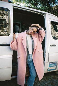 {Powder pink coat and denim.}