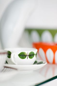 Bersa coffee cup by Stig Lindberg ...with Catherine Holm bowls in background __ photo by h4ndz/Jan Skacelik, via Flickr