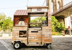 Luzzo's tiny pizza cart with a wood-fired oven.