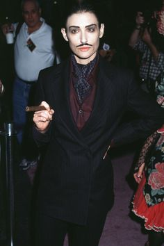 Demi Moore dressed as Gomez Addams at a Halloween Event.