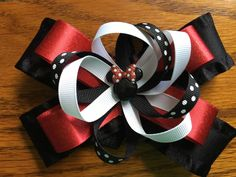 A personal favorite from my Etsy shop https://www.etsy.com/listing/386631874/6-inch-minnie-mouse-hairbow