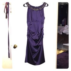 Beautiful eggplant dress with rhinestone collar I wore this dress to a wedding and it was perfect! Love the subtle shade of purple. The rhinestones make it easy to style. The rouged sides makes it super flattering. A few snags in the material but it's not noticeable when you're wearing it. See the last photo. Dresses