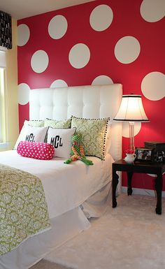 the polka dot wall makes the room look like the inside of a victoria secret Pink box <3