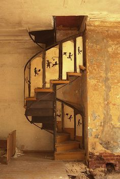 spiral stairs with a kite flying motif in an abandoned mansion | interior design ideas + architectural details