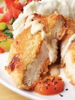 Macadamia Nut Crusted Chicken from Kona Grill...serve with Shoyu Cream Sauce, Mango Chutney and White Cheddar Mashed Potatoes!
