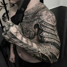 Armour tattoo ideas for men shoulder sleeve and chest Armor Sleeve Tattoo, Armour Tattoo, Shoulder Armor Tattoo, Body Armor Tattoo, Best Sleeve Tattoos, Body Art Tattoos, Forearm Tattoos, Shoulder Sleeve, Mens Body Tattoos