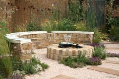 Build a fire pit similar to this in our blank-slate back yard. The brickwork is great, especially the colors, and would blend well with the pavers we will use for the patio and walkways.