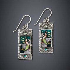 """Dance of the Kelpies Earrings""  Silver Earrings Created by Dawn Estrin Mermaids dance gracefully inside this miniature art deco style ""earquarium"". Sterling silver accented with Swarovski crystal.   This item pairs particularly well with the coordinating Ring. Dimensions: 0.5in W x 1.25in L x 0.63in D"