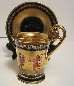 Royal Vienna Cabinet Cup w Saucer - The childen are celebrating Erntefest, which is the German fall harvest festival.  The Cup is signed by the artist which looks like Vilmer.