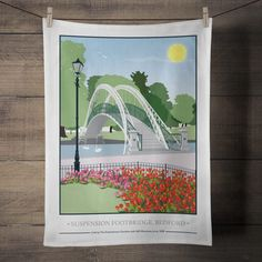 The Suspension Footbridge, Bedford Embankment Tea Towel  £8.00  My Suspension Footbridge, Bedford Embankment print is now available as a Tea Towel.  Designed by myself and professionally digitally printed and constructed in the UK on 100% Cotton Tea Towel complete with hanging loop. Tea Towel is packaged in branded packaging making it the perfect gift or treat for yourself! Tea Towel Dimensions: 45.5cm x 70cm. Wash care instructions: Wash Max 40 degrees.