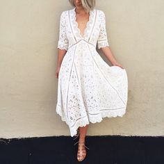 Julia in Zimmermann Los Angeles wears the Hyper Eyelet Broderie Dress.