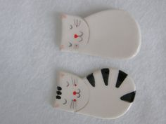 Hey, I found this really awesome Etsy listing at http://www.etsy.com/listing/125027549/pair-of-2-cute-ceramic-magnets-cat