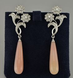 Art Nouveau inspired double flower top elongated drop earrings set with diamonds and pink opal