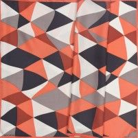 Funky harlequin print in strong graphics, creme, black, grey and coral.