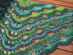 Pattern (free) virus shawl - I am in the process of making this. It's super fast and rewarding! Lends itself well to the self striping yarns!