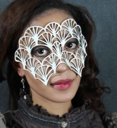 Fan leather mask in white. $39.00, via Etsy.