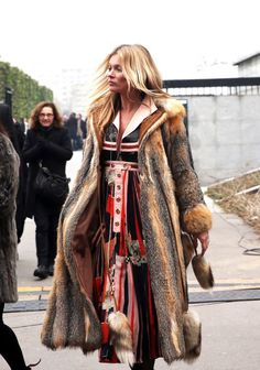 Kate Moss leaves Louis Vuitton's men's F/W 2015/2016 fashion collection