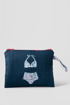 Bikini Bag with Floral Bathing Suit. The waterproof lining keeps your wet bathing suit separate from all of your other dry items. The functional yet stylish bag is a great addition to your summer accessories.