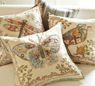 I am really liking these pottery barn pillows