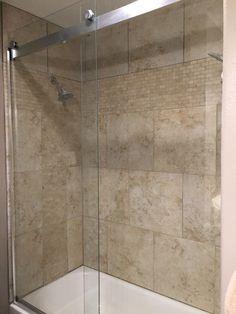 Tan shower with Kohler shower doors