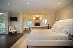 Beautiful bedroom with sitting area beyond