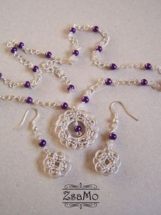 Helm and Purple. Notice the spiral part of the headline on the last bead of the necklace.