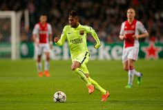 Neymar of Barcelona breaks with the ball during the UEFA Champions League Group F match between AFC Ajax and FC Barcelona at The Amsterdam Arena on November 5, 2014 in Amsterdam, Netherlands.