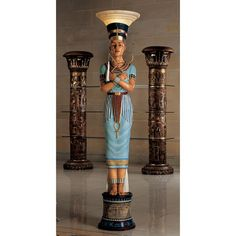 "Design Toscano Queen Nefertiti Sculptural Floor Lamp 75""H x 13""W Our nearly life-size Egyptian Revival masterpiece taps beauty of this legendary queen to shed light on her modern subjects. Blending art, architecture & elements of fine design, our quality designer resin lamp is hand-painted in colors of Egyptian palette to become an exquisite 360-degree sculptural art piece. Topped with stunning glass shade(60watt bulb)this exclusive is controlled by pedal switch It's an amazing signature…"