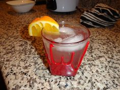 Orange Gin Tonic  --fresh squeezed orange juice  --1oz triple sec  --2oz gin  Mix in shaker with crushed ice.  Pour into rocks glass.  Top with tonic water and garnish with orange slice.  Enjoy
