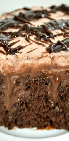 Quadruple Chocolate Poke Cake aka Death By Chocolate Poke Cake! Amazingly Moist Chocolate Cake, with a rich layer of chocolate pudding, a layer of gooey fudge sauce then a fabulous layer of fluffy chocolate mousse like topping!