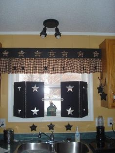 wooden shutters and curtains for kitchen window..
