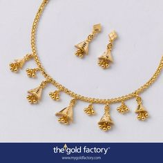 A merry little necklet in the form of a celebratory bunting with a a series of chhela half-cone bells and ball clusters. It's a pick-me-up jewel ; one that's sure to put you in a good mood. Handcrafted in 22K hallmarked gold, it's got a pair of cute half-jhumkas to go with it. Perfect post-bandh ornament to start the run-up to Poila Baisakh festivities.