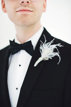 #Black & white wedding groom with feather boutonniere... Wedding ideas for brides, grooms, parents & planners ... https://itunes.apple.com/us/app/the-gold-wedding-planner/id498112599?ls=1=8 … plus how to organise an entire wedding ♥ The Gold Wedding Planner iPhone App ♥