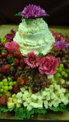 Affordable version of a cheese wedding cake display  Adeline Leigh Catering - Appetizing Appetizer Displays