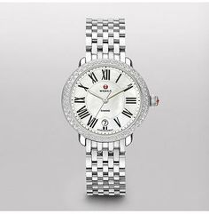 Serein 16 Diamond Feminine, elegant and timeless, 88 hand-set diamonds adorn the stainless steel Serein 16 timepiece. Roman numerals and the signature MICHELE logo grace the mother-of-pearl dial. The stainless steel bracelet is interchangeable with any 16mm MICHELE strap.
