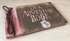 A scrapbook to chronicle all the adventures you've had with the Ellie to your Carl. | 30 Magical Disney Decorations You Need In Your Life