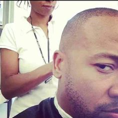 Trimmin up Columbus Short on the set of Scandal.