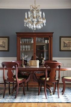 The Best Dining Room Paint Color Dining Room decor ideas - formal traditional style dining room with wood table, chairs, crystal chandelier, white wainscoting and grey wall (Templeton Gray by Benjamin Moore) Blue Dining Room Paint, Dining Room Sets, Paint Colors For Living Room, Dining Room Walls, Dining Room Design, Dining Room Furniture, Dinning Table, Wood Table, Dinning Room Paint Ideas