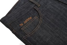 Luxire jeans constructed in Dark Indigo Stretch Jeans: http://custom.luxire.com/products/dark_indigo_stretch_jeans_13_oz  Initial embroidered above coin pocket.