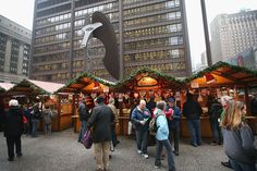 """Illinois Chicago's Chrstkindlmarket on the famous Daly Plaza runs from just before Thanksgiving through Christmas Eve. This holiday market is based on traditional German markets, which is why the Grand Opening Ceremony features a German """"Christ child,"""" a fairy-like being dressed in gold and white robes, wearing a crown upon her golden locks. Vendors from around the world sell ornaments, jewelry, wooden treasures, embroidery, and delicious food."""