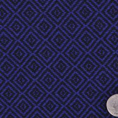 This is a heavy weight woven, wool blend, with a diamond pattern. Great for unique coating.