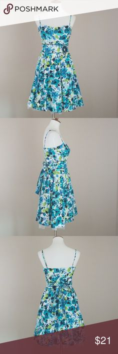 B.Darlin Blue,Green &Turquoise Floral Sundress Blue, green & turquoise floral dress from B.Darlin. Sweetheart neckline. Adjustable spaghetti straps. Zips up back and ties in back. Flower applique on front waist. Lined w/ Tulle under skirt for added flair.  Laying flat chest measures 15'. Waist 13' Total length of dress is 28.5'. 97% Cotton 3% Spandex. Lining 100% Polyester. Cute dress for a night out or special occasion!! B Darlin Dresses