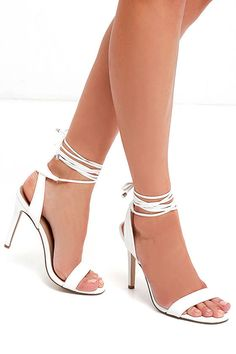 They are playing your song! So head out to the dance floor in the Turn It Up White Leg Wrap Heels! White vegan leather trims a slender toe strap and quarter strap, while extra long laces (with gunmetal aglets) wrap and tie around the calf.