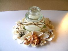 great way to recycle an old cd, some treasures from the summer's beach-combing - use a jar candle in the center
