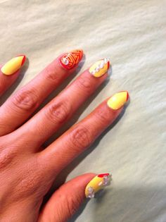 Med length Press on Nails  yellow and orange w/ swarovski crystals. $23.00, via Etsy.