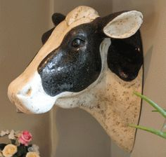 A fabulous black and white Fresian life size cow's head - amazing in the garden and truly memorable if she hangs in your kitchen! £169