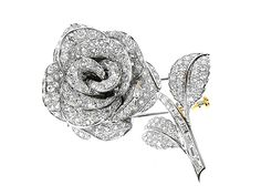 All Platinum All Diamond rose brooch Diamonds 8.42cts  http://www.luciecampbell.com/brooches/All/1070--/  £7000  richard@luciecampbell.com  Lucie Campbell Jewellers Bond Street London  http://www.luciecampbell.com