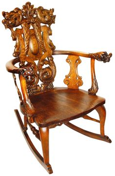 This ornately carved rocker is a Stickley, but not Gustav Stickley's work; it was made by brother Charles Stickley and the Stickley-Brandt Furniture Company.